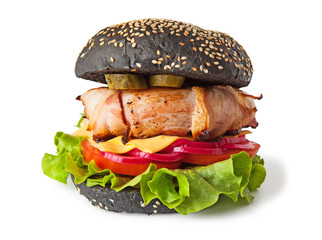 Homemade, black hamburger, cheese burger on a white background.