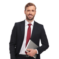 portrait of handsome businessman holding tablet and laughing