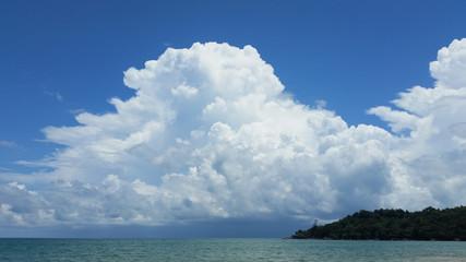 A big, white cloud on the blue sky