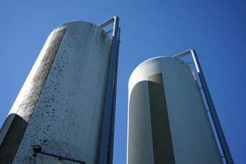 Two animal feed silos.