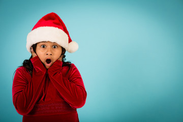 Shocked Christmas Girl Wearing Santa Hat, Room for Text