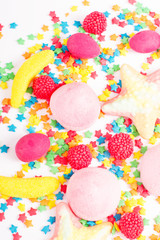 Colorful candy, lollipop and sweets isolated on white background. Top view. Selective focus.