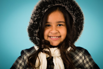 Happy Winter Girl All Bundled Up, Isolated in Studio
