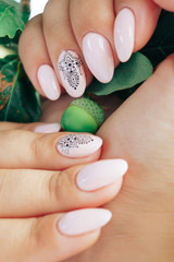 beautiful manicure close-up with a purple flower
