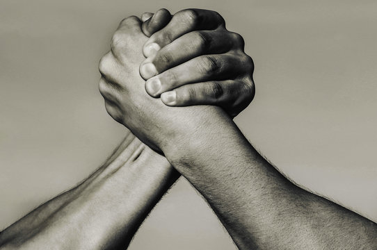 Hand, rivalry, vs, challenge, strength comparison. Two muscular arm. Rivalry concept. Man hand. Two men arm wrestling. Arms wrestling. Leadership concept, hands. Closep up, macro. Black and white.