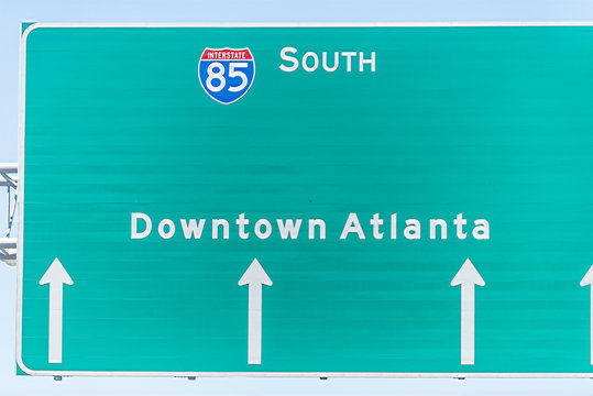 Atlanta, USA I-85 Interstate 85 highway road street during day in capital Georgia city, closeup of isolated green sign for downtown directions arrows