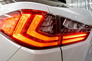 Taillight, headlight of modern prestigious luxurious car. Closeup, macro view of LED xenon car's headlamp, lamp headlight