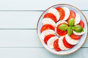 Classic caprese salad. Mozzarella tomatoes and  Basilikum.