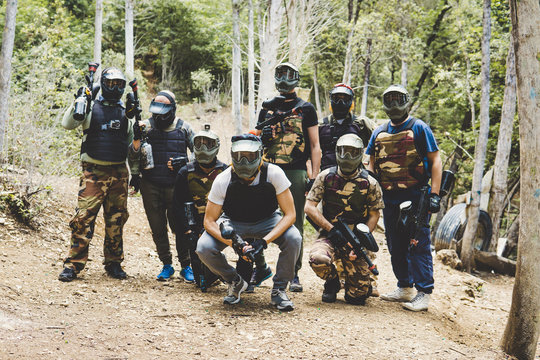 Group of adults with masks and paintball guns
