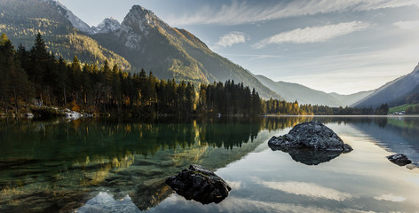 Amazing foggy morning. Dramatic mountain Scenery, Sunset at Hintersee Lake. Majestic Mountains, reflected in Water. Beauty in the nature. Nationalpark Berchtesgadener Land, Upper Bavaria, Germany.
