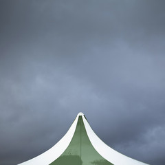 View of tent against cloudy sky