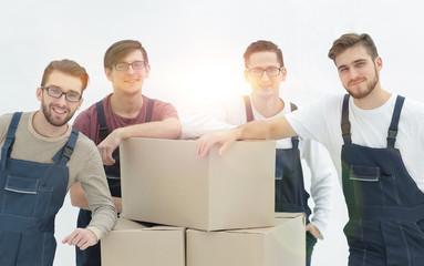 Men holding pile of carton boxes isolated on white background