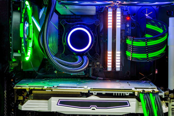Close-up Desktop PC Gaming and liquid cooling cpu with LED RGB light show status on  working mode, interior pc case technology background