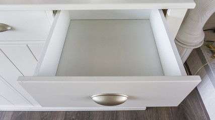 Fototapeta background empty modern white wooden cabinet drawer that is open and is empty obraz