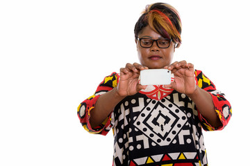 Studio shot of fat black African woman taking picture with mobil