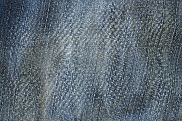 Blue fabric./ Texture of denim jeans background