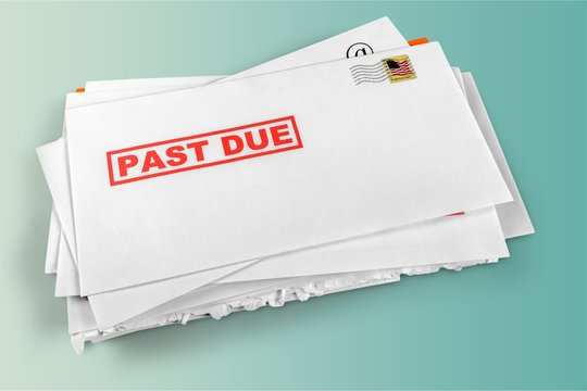 Pile of envelopes with overdue utility bills