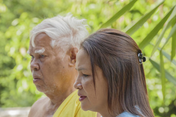 Asian senior man outdoor with his adult daughter