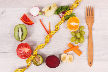 Cantimeter and clock made of fruits and vegetables containing minerals, time to diet and slimming concept
