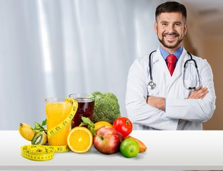 Young handsome dietology specialist with healthy food