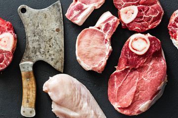 different meats pork chicken fillet beef butcher knife black background top view