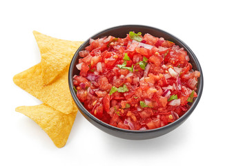 Tomato salsa dip top view isolated on white background