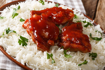 Catalina chicken is smothered in the tastiest sweet and tangy Catalina sauce and rice garnish close-up on a plate. Horizontal