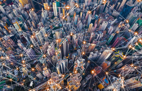 Digital network connection lines of Hong Kong Downtown. Financial district and business centers in smart city in technology concept. Top view of skyscraper and high-rise buildings. Aerial view