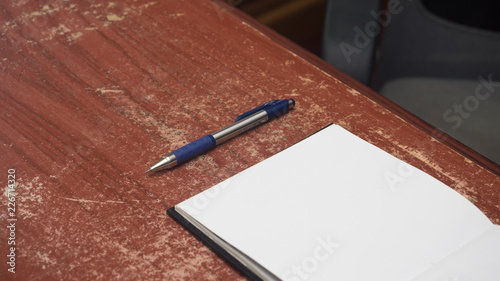 Wall mural top view pen and notebook on wood table