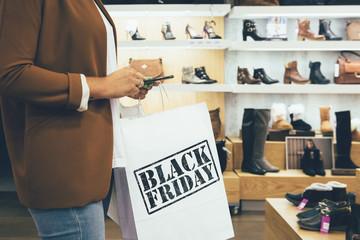 Female shopper uses smart phone