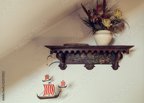 Cardboard Ships Hanging From Old Wooden Shelf With Dried Flowers