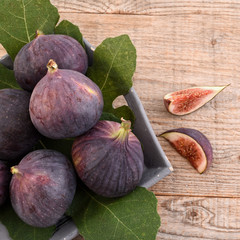 Figs, fruits on wooden background.