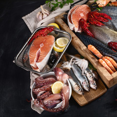 Fresh fish and seafood variety with spices.
