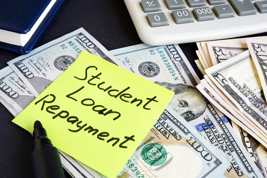 Money for Student Loan Repayment on a table.