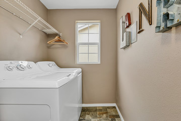 Laundry room interior with washer and dryer