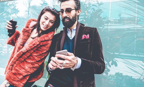 Trendy influencers people using smartphone social media app