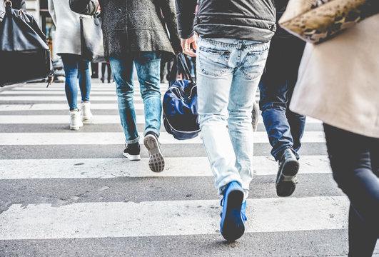 Crowd of people walking on zebra crossing street city center