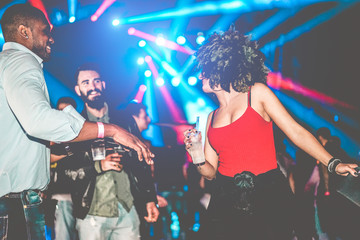 Happy friends having party in night club