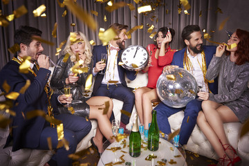 Group of people partying among confetti