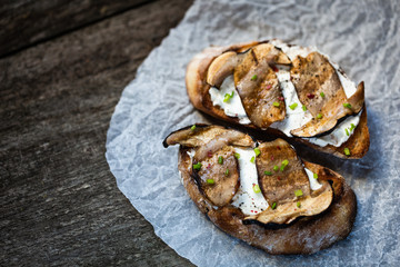 Bruschetta with porcini mushrooms and soft cheese