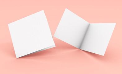 Obraz blank square bifold brochure on pink background - fototapety do salonu
