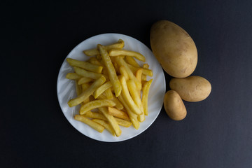 Potato fry on dark background with selective focus and crop fragment
