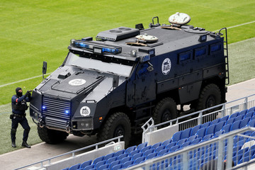 A member of French special forces RAID unit takes part in a drill inside the Groupama Stadium in Decines
