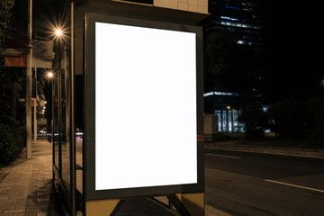 Bus stop display with white blank space for advertisement at night. Mock-up design concept. Horizontal