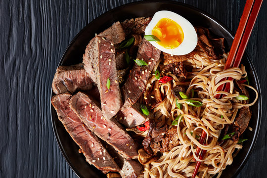 black bowl of Soba noodles with sliced roast beef