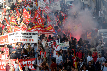French CGT labour union members hold banners during a demonstration to protest against the French government's reforms in Marseille