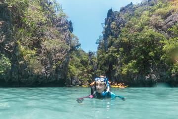 Female snorkeling underwater - Adventure travel lifestyle enjoying happy fun moment - Trip around Philippines wonders