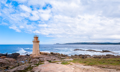 Seascape with cliff and lighthouse. Muxia Spain
