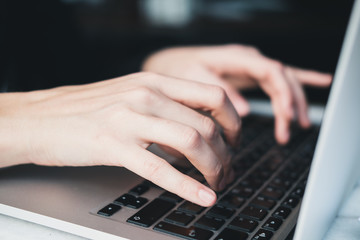 Closeup of woman's hands working on laptop at home. Freelance concept. Horizontal