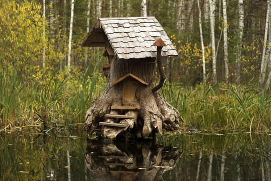Rerm, Russia - Octoder 02, 2018: art object - house of fairy creatures in stump on the swamp